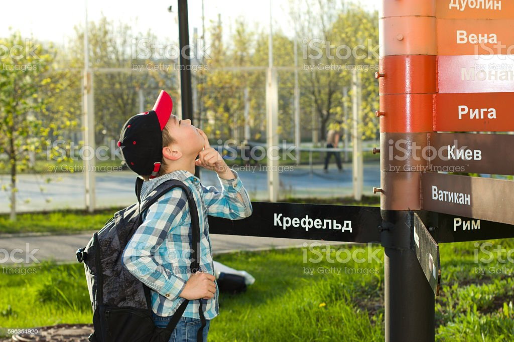 Boy stands near the column royalty-free stock photo