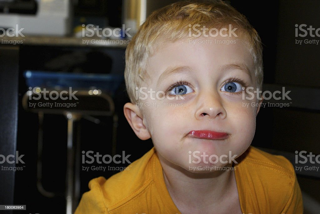 Boy Stinking Lip Out Making a Funny Face stock photo