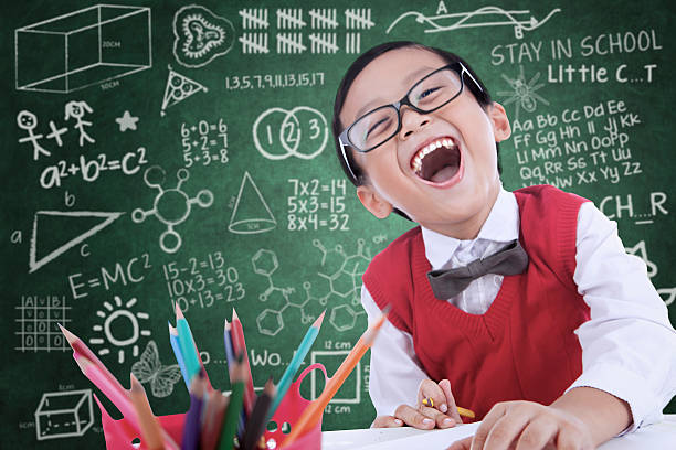 Boy student laughing in class stock photo