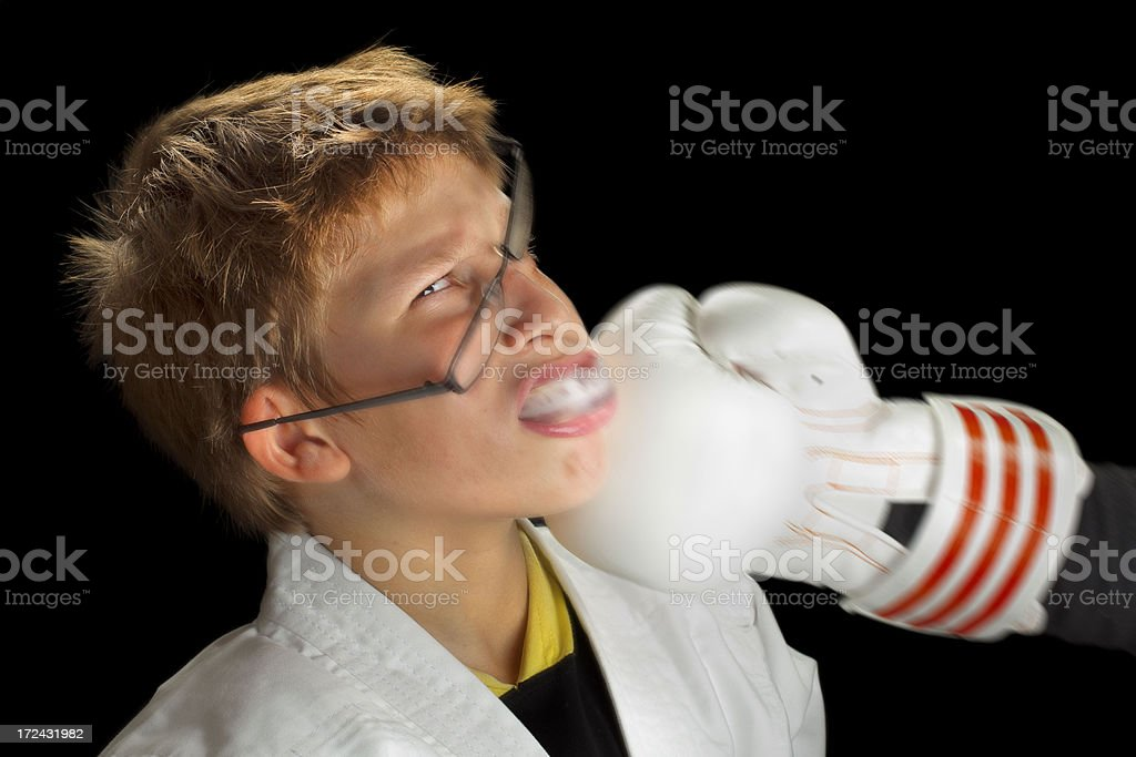 Boy Student take hard punch hit in training royalty-free stock photo