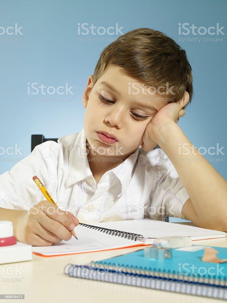 Boy studying royalty-free stock photo