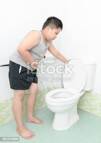 istock boy suffer stomach and vomit in toilet, diarrhea 952626666