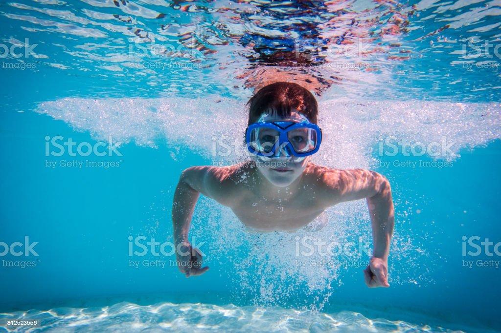 Boy swim in swimming pool stock photo