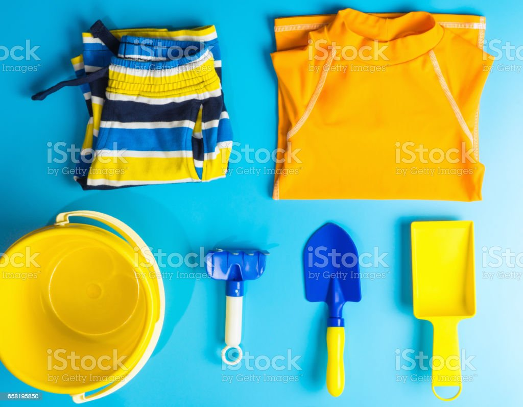 Boy Swiming suit and beach accesories flat lay for Summer vacation theme stock photo
