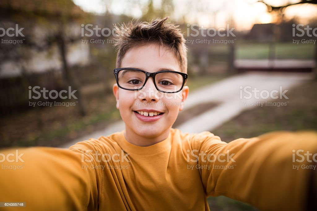 Boy takes selfie stock photo