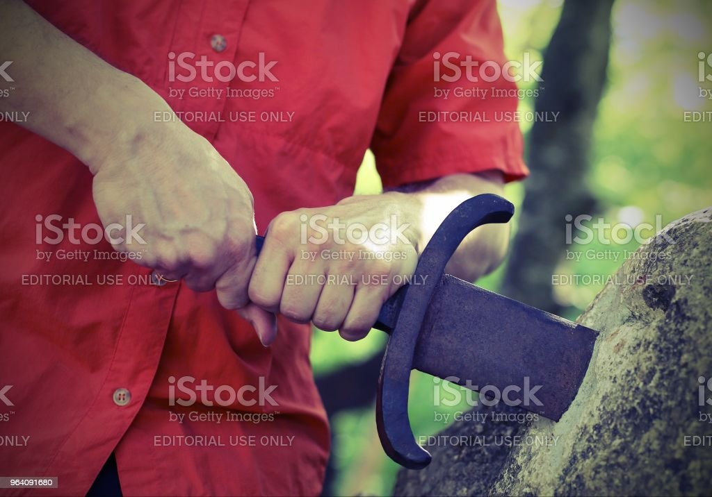 boy takes the excalibur sword in the stone with vintage effect - Royalty-free Adult Stock Photo