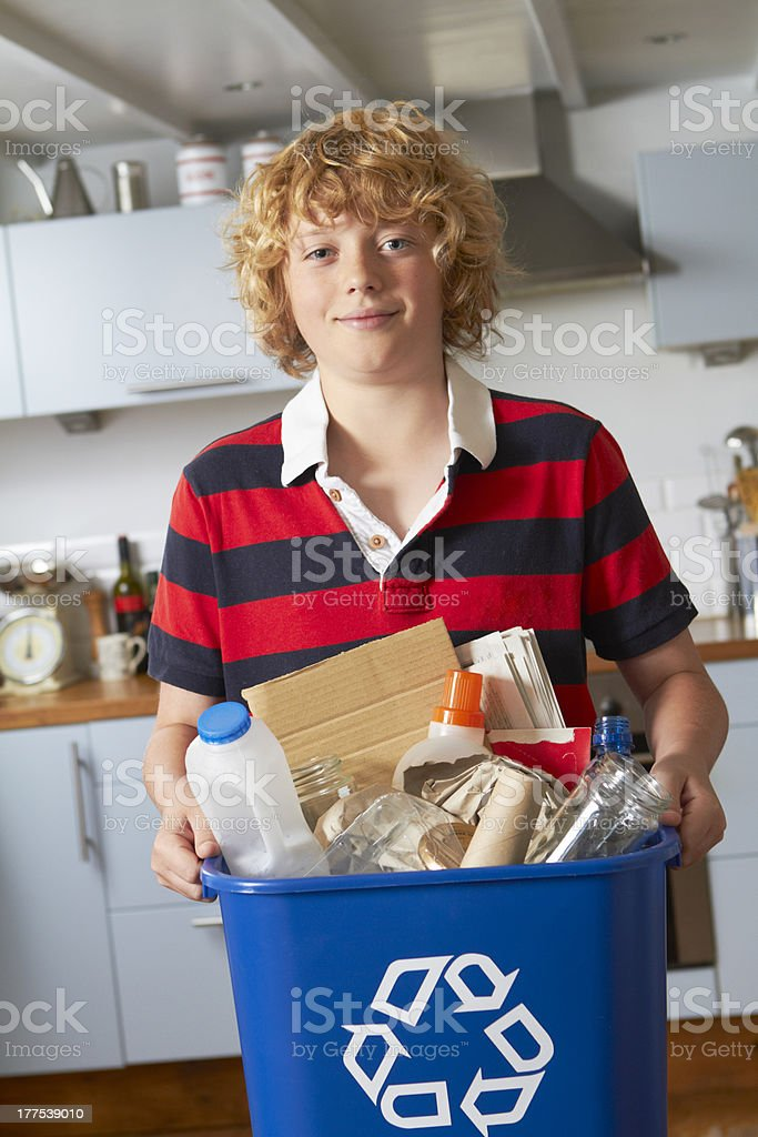 Boy Taking Out Recycling stock photo