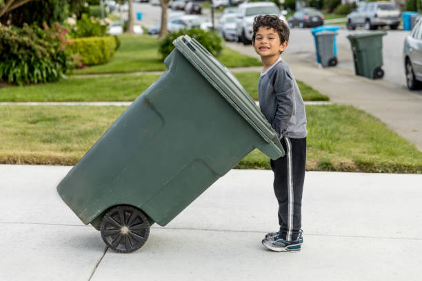 Boy Taking out Trash stock photo