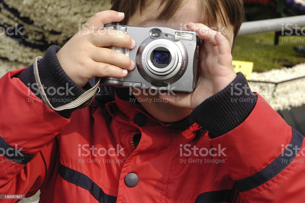 Boy taking picture: Smile! royalty-free stock photo