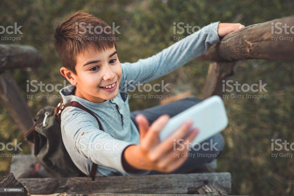 Boy taking selfie stock photo