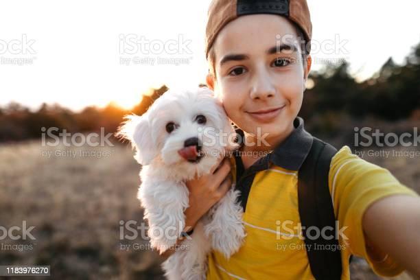 Boy taking selfie with maltese dog picture id1183976270?b=1&k=6&m=1183976270&s=612x612&h=5vrn2wi4xnkqcqmv8rh57izimcuqnlgj9sihbj6zb9a=
