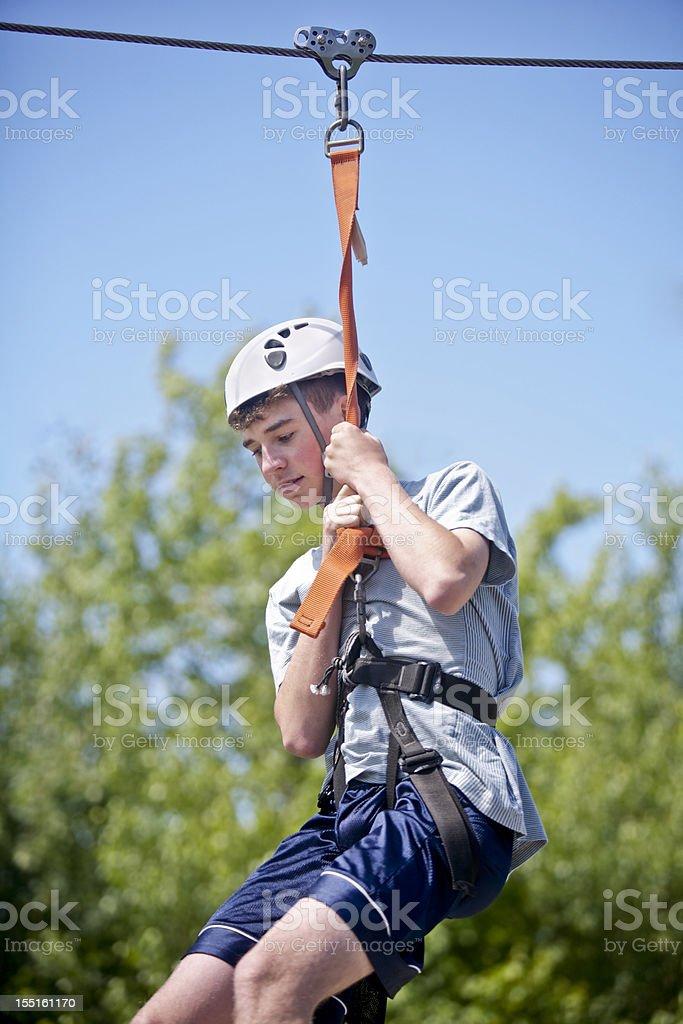 Boy  taking  Zipline Trip down a Mountain royalty-free stock photo
