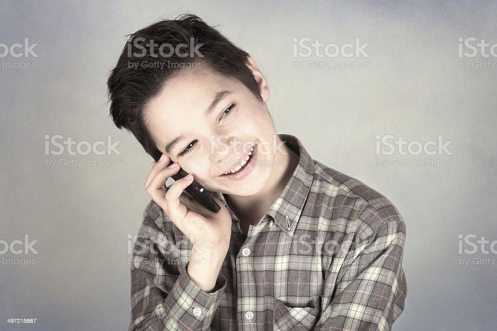Boy talking on the phone stock photo