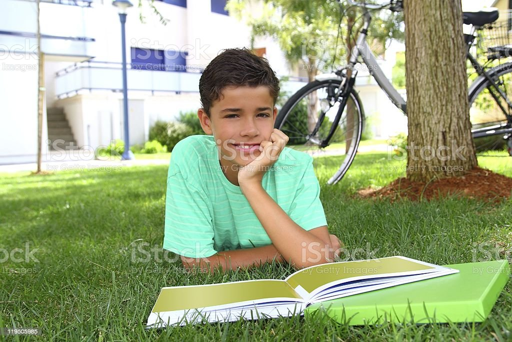 boy teen studying laying green grass garden royalty-free stock photo