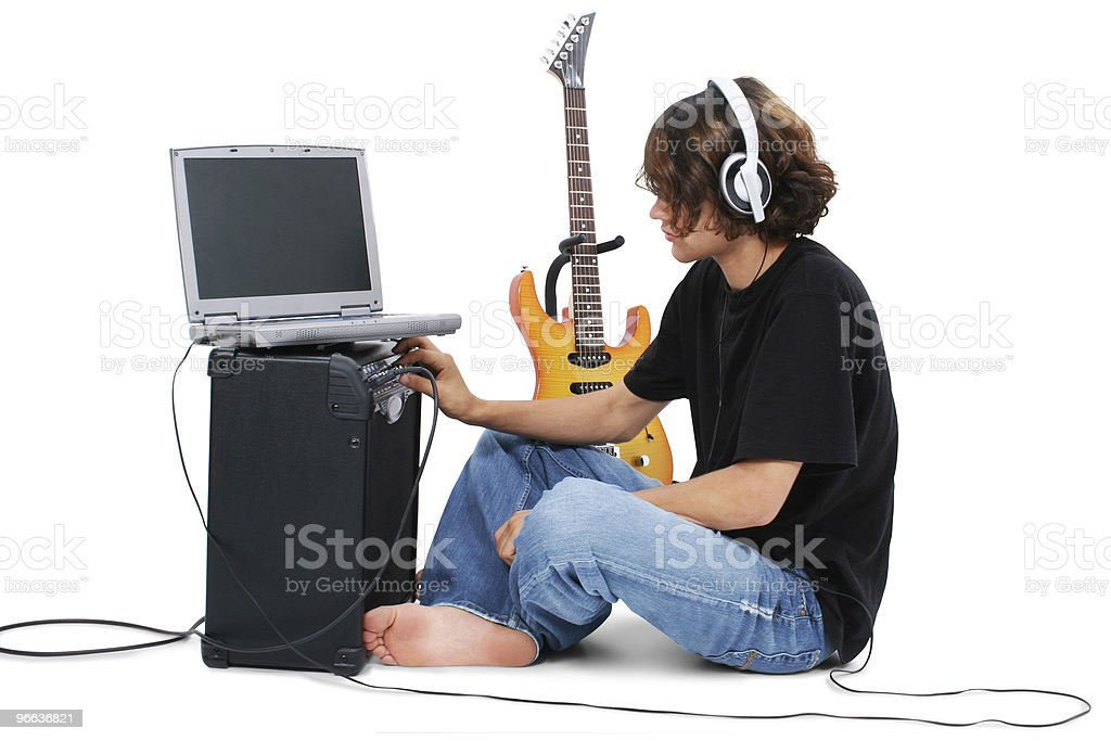 Boy Teenager With Electric Guitar Amp And Laptop stock photo