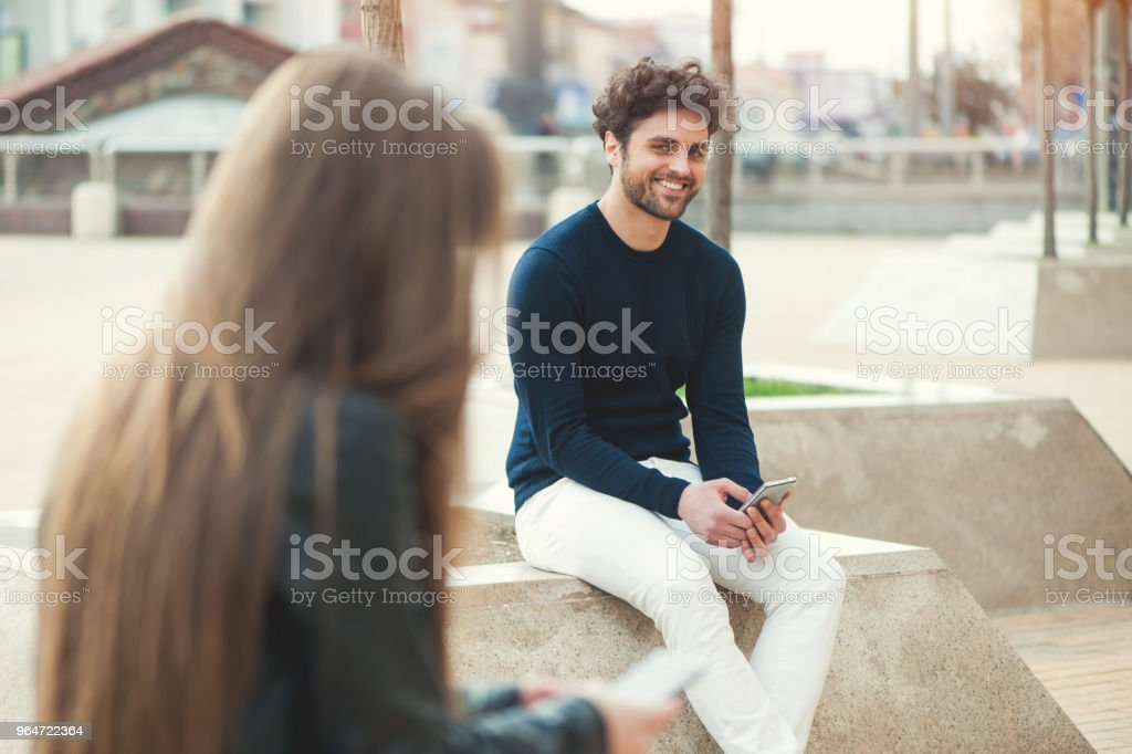 Boy and girl flirting royalty-free stock photo