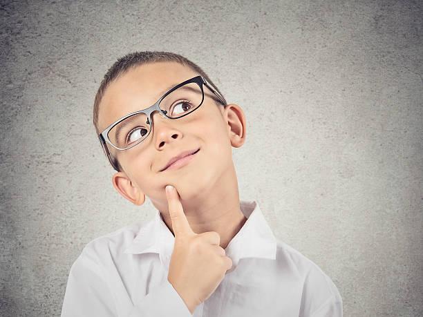 Boy thinking, daydreaming stock photo