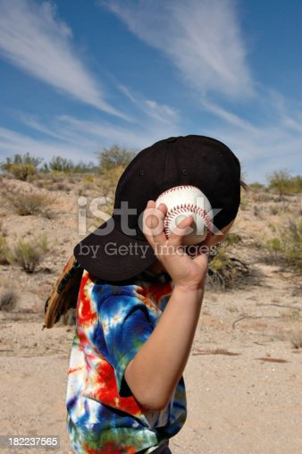 istock Boy Throwing Baseball 182237565