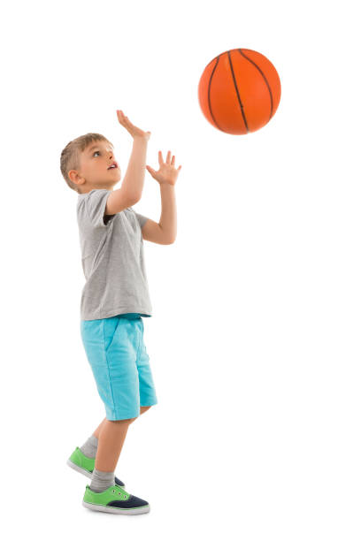 Boy Throwing Basketball stock photo