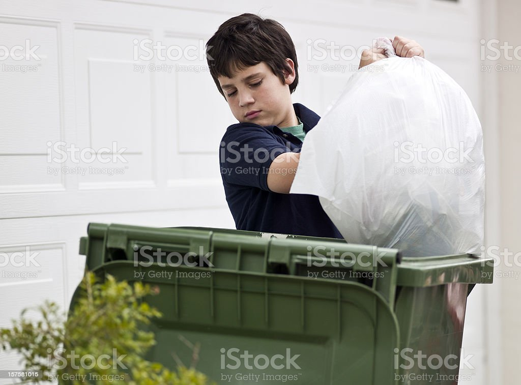 Boy throwing out the garbage stock photo