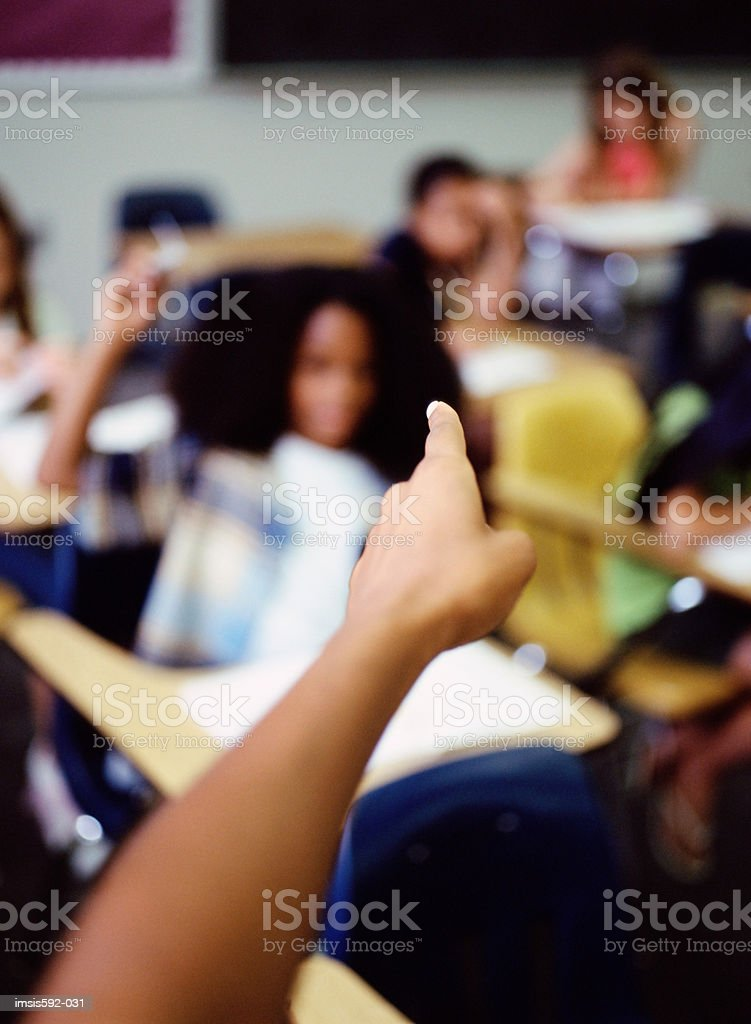 Boy throwing paper aeroplane in classroom royalty-free stock photo