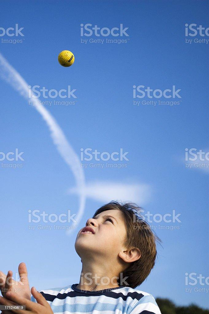 Boy throws ball royalty-free stock photo