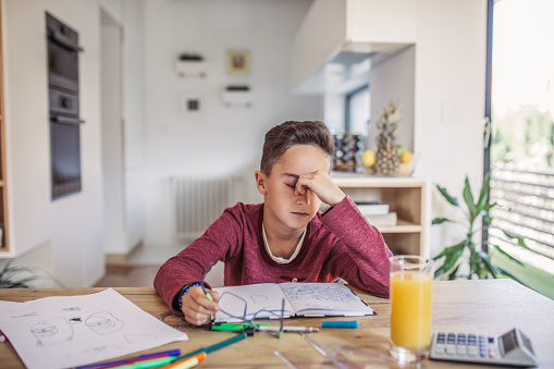 istock Boy tired of doing math 1051514476
