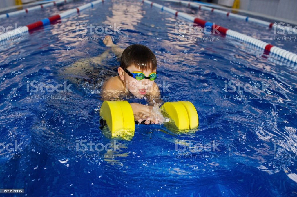 Boy trained wim in the pool stock photo
