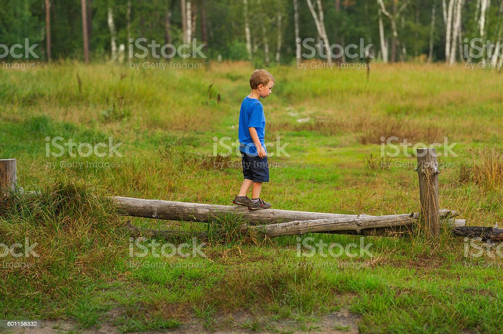 boy training balance stock photo