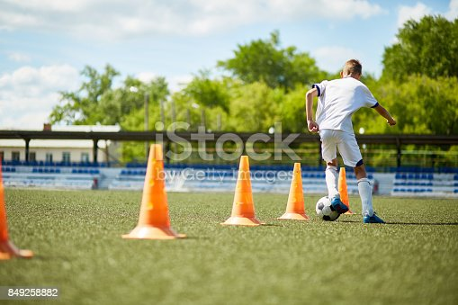 istock Boy Training for Football Game 849258882