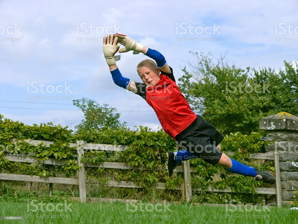 Boy training goalkeeping stock photo