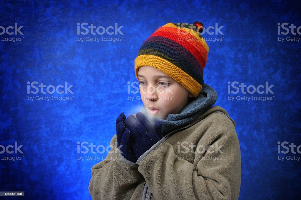 Boy trying to warm his hands royalty-free stock photo