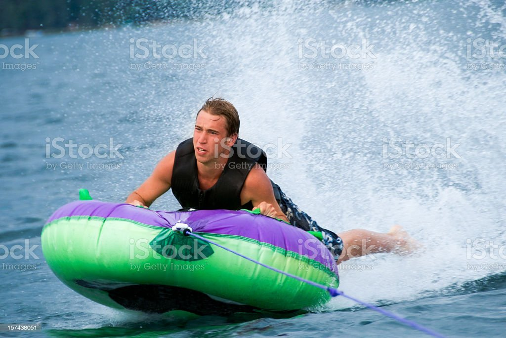 Boy tubing royalty-free stock photo