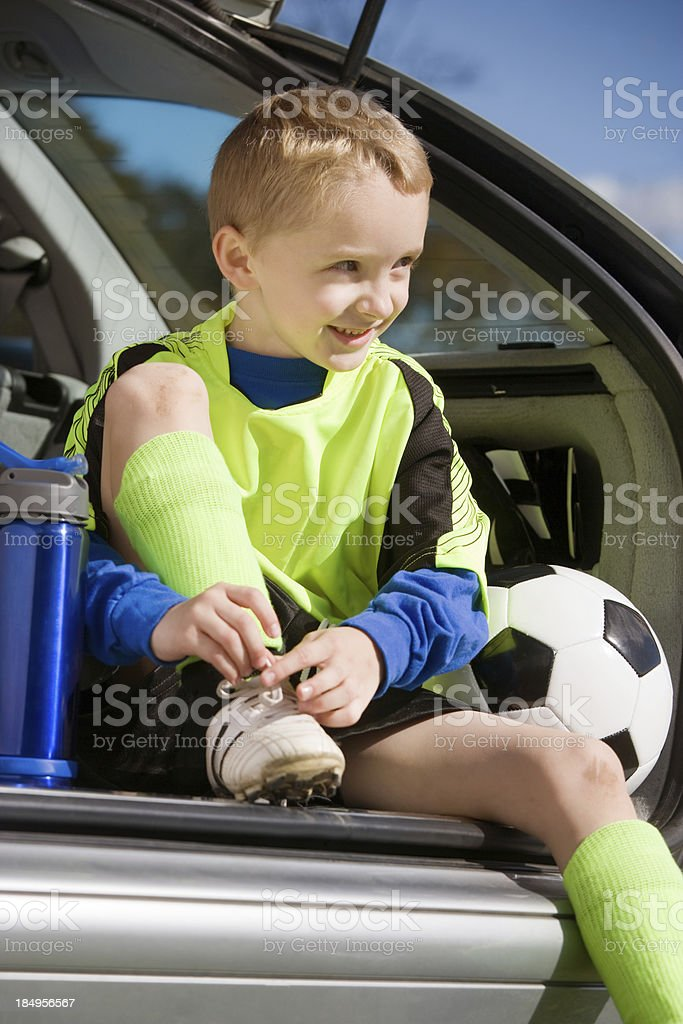 boy tying his soccer cleat royalty-free stock photo