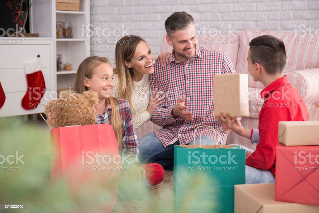 Boy unpacking presents stock photo