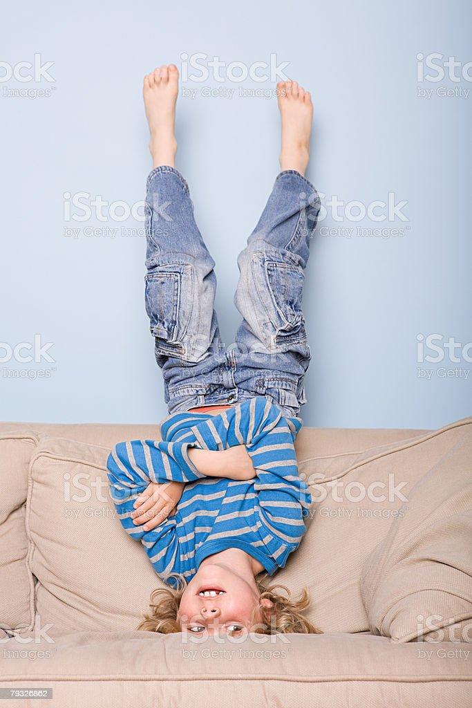 A boy upside down