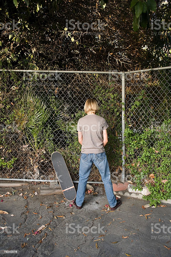 A boy urinating stock photo