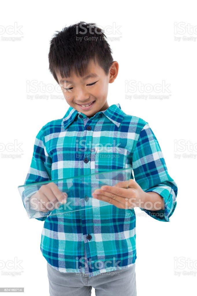 Boy using a glass digital tablet stock photo