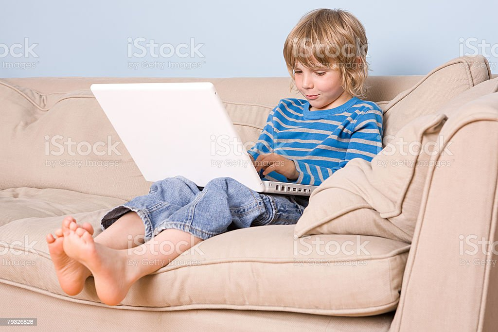 A boy using a laptop 免版稅 stock photo