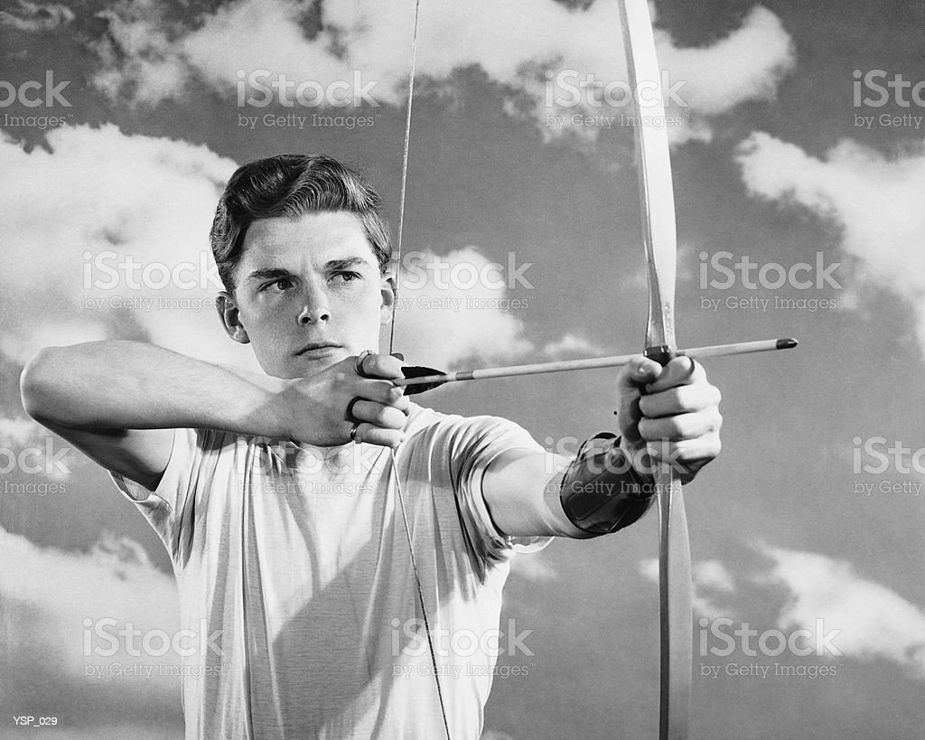 Boy using bow and arrow royalty-free stock photo