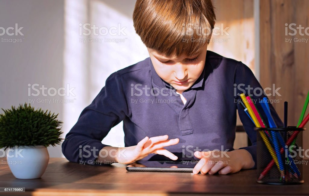 Boy using digital tablet stock photo