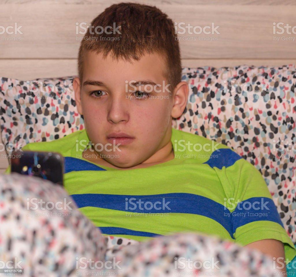 Boy using mobile phone 1 stock photo