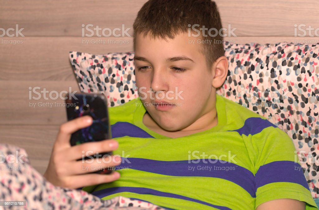Boy using mobile phone 2 stock photo