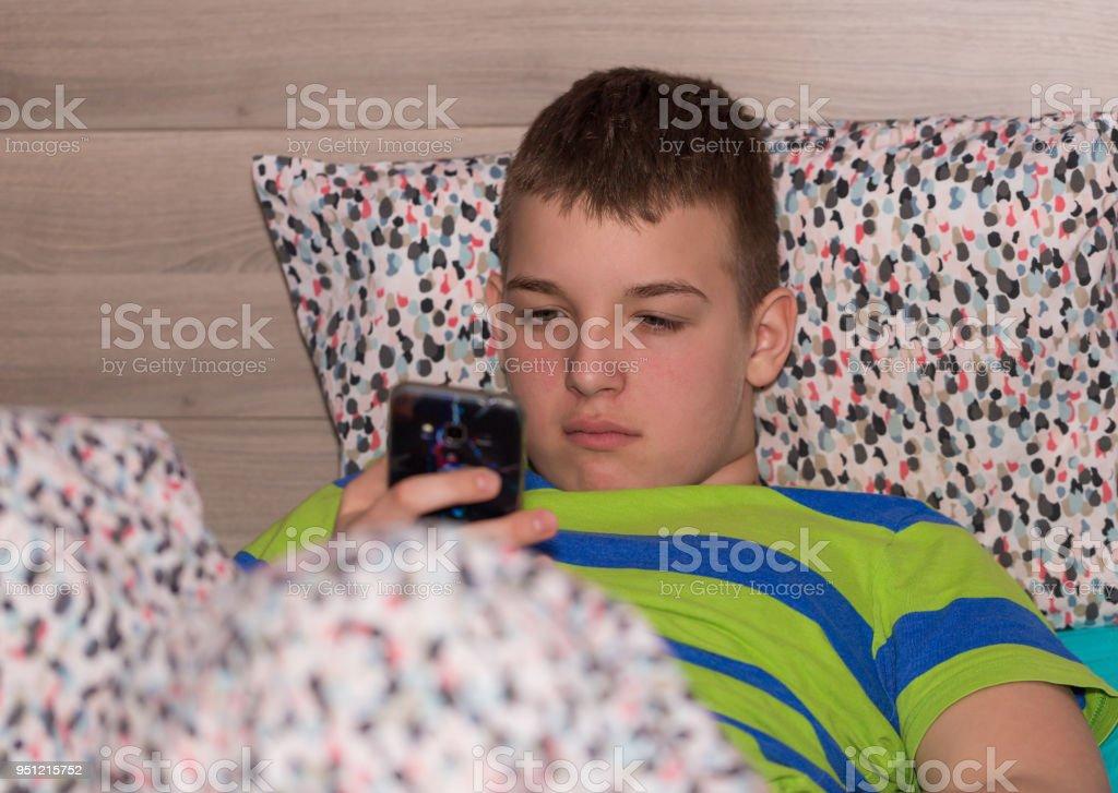 Boy using mobile phone 3 stock photo