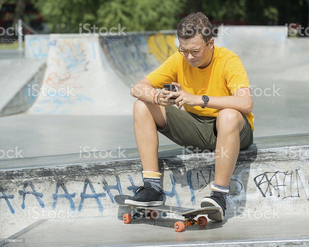 Boy Using Smart Phone royalty-free stock photo