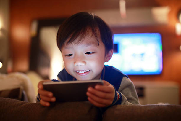 Boy Using Smart Phone stock photo