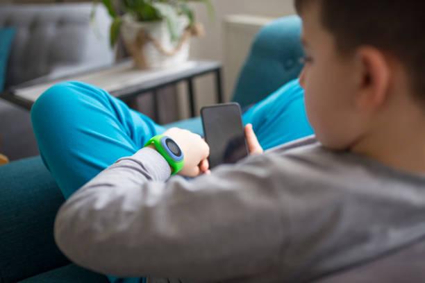 Boy Using Smart Watch stock photo