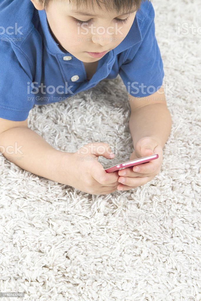 Boy using smartphone royalty-free stock photo