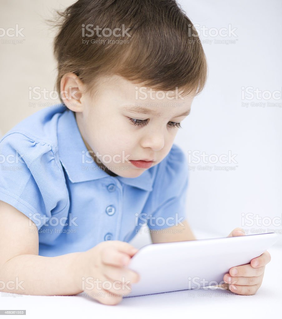 Boy using tablet royalty-free stock photo