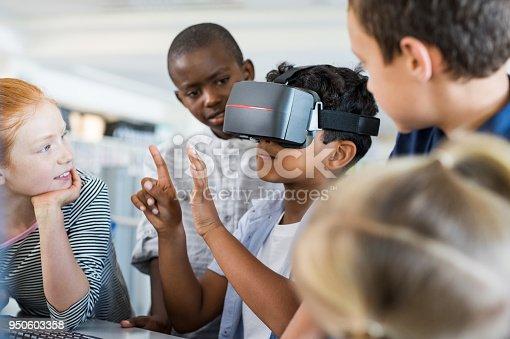 istock Boy using virtual goggles 950603358